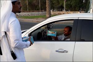 Sealine Beach Resort volunteers distribute  iftar for motorists in Mesaieed and Al Wakrah